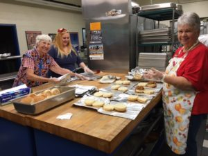 Barb, Vicki and Ashley keep VERY busy making sandwiches.